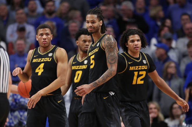 Missouri forward Mitchell Smith (5) reacts with guards Javon Pickett (4), Torrence Watson (0) and Dru Smith (12) during a game against Kentucky last season at Rupp Arena in Lexington, Ky.