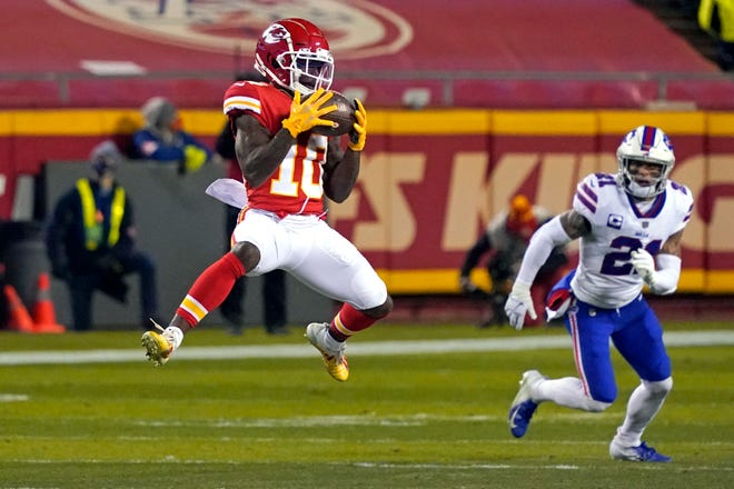 Kansas City Chiefs wide receiver Tyreek Hill (10) catches a pass ahead of Buffalo Bills safety Jordan Poyer, right, during the AFC championship game Jan. 24 in Kansas City.