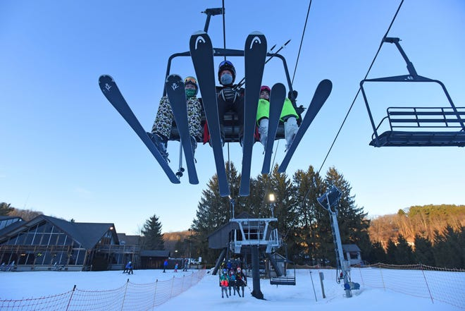 A trio of skiers take the lift to the top of Mount Mansfield at Snow Trails in Mansfield on Jan. 29.