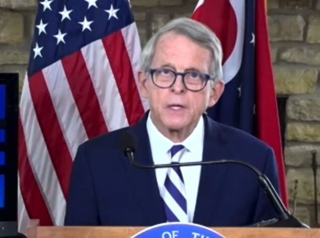 Gov. Mike DeWine is tucking some gun reform proposals into the pending state budget bill.