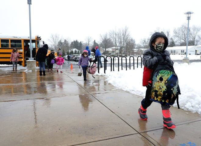 After 11 months of online learning, about 18,000 Columbus City Schools students finally headed back to buildings on Feb. 1. Students maintain social distancing after arriving at Ecole Kenwood French Immersion Elementary School on the Northwest Side.