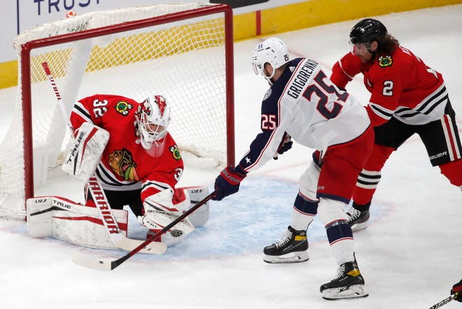 Blue Jackets forward Mikhail Grigorenko sees his second-period shot saved by Chicago goaltender Kevin Lankinen in the Blackhawks' 3-1 victory on Sunday.