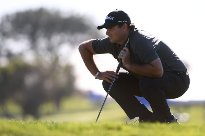 Patrick Reed lines up a putt on the 17th hole during the third round of the Farmers Insurance Open near San Diego. Earlier in the round, Reed picked up a ball that he believed had plugged in the rough in wet conditions.