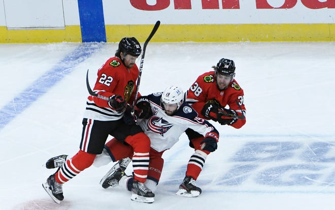 On Friday, Blackhawks forward Ryan Carpenter (22) was credited with a hit on the Blue Jackets Liam Foudy (19). A day later, Carpenter and a teammate were placed on Chicago's COVID-19 protocols list. Should Foudy and the Jackets worry?