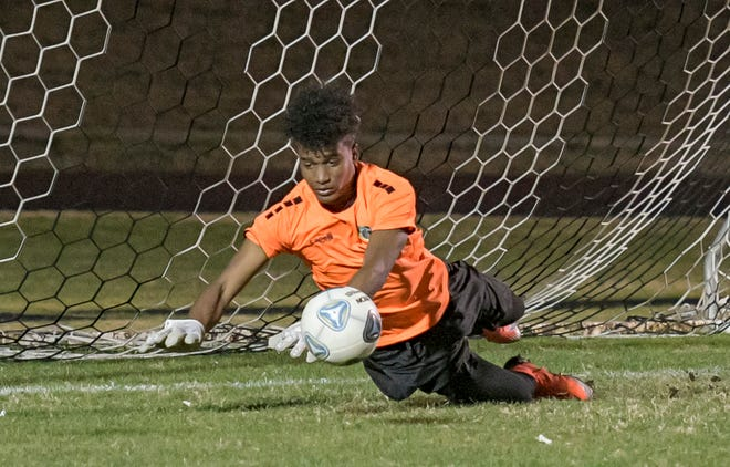 East Ridge goal keeper David Herrera (1) makes a save on Jan. 22 against Lake Minneola. East Ridge is seeded third in the Class 7A-District 5 tournament as boys and girls soccer and girls basketball teams head into district tournaments this week. [PAUL RYAN / CORRESPONDENT]