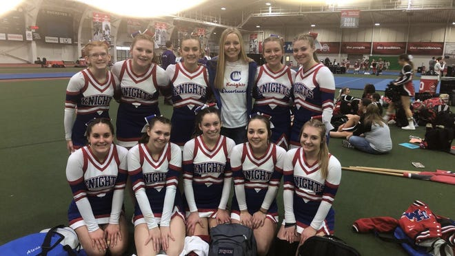 The West Holmes competitive cheer team poses during a competition in early 2020.