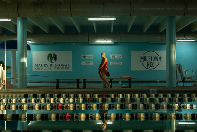 Lifeguard Kara Preston patrols the pools at the Muletown Rec health and wellness center during the first day of the aquatics center's reopening following a grassroots initiative to save the pools from closing in Columbia, Tenn., Friday, Jan. 29, 2021.
