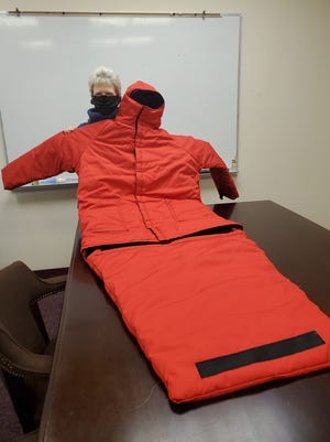 Cindy Daniel of Lexington has created a GoFundMe page to raise funds to purchase a versatile waterproof coat for the homeless that can also be used as a sleeping bag or folded up to carry easily over the shoulder. The lower section, when it is functioning as a sleeping bag as seen in this photo, can be folded up and use the black velcro strip to attach it to the inside, back section of the coat.