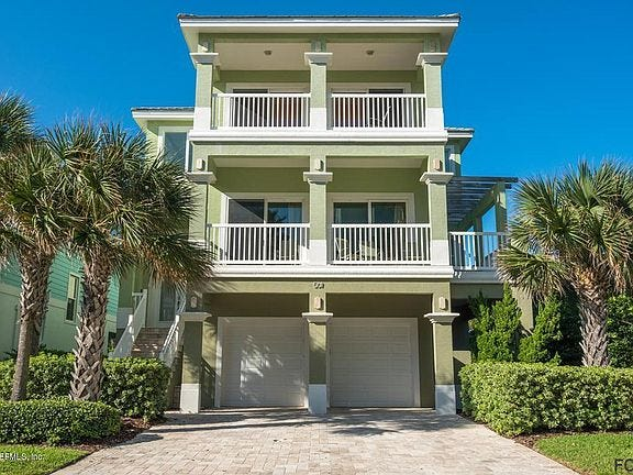 This beachside home on Cinnamon Beach Lane sold recently for $1,160,000. It has six bedrooms and 5 1/2 baths in 3,858 square feet of living space, and it also has a guest bedroom and living area, a screened pool and spa, a patio with a firepit, a master bedroom with a private balcony, an elevator and four balconies. It was built in 2012.