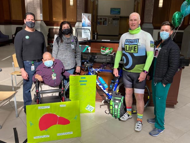 Michael Sage of Praireville celebrated the fifth anniversary of his liver transplant by riding his bicycle from Prairieville to Tulane Medical Center in New Orleans. He is shown with Tulane staff members.
