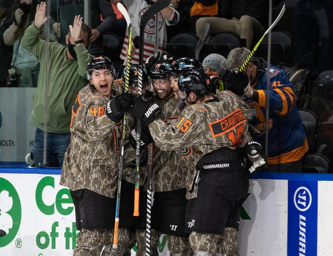 Kansas City Mavericks forward Rob Bordson (19), center is mobbed by teammates after scoring one of his two goals in a 2-1 victory over the Tulsa Oilers Saturday at Cable Dahmer Arena.