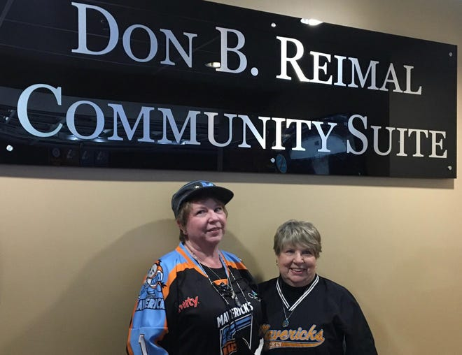 Jo Reimal, right, wife of the late Don Reimal, and their daughter Kathleen Cannady are shown in front of the plaque noting the Cable Dahmer Arena suite dedicated Saturday for the former Independence mayor, who helped guide the arena's construction and secure a minor league hockey team to play there. Don Reimal, who was mayor from 2006 to 2014 and served on the City Council for 12 years before that, died last year at the age of 78. The city dedicated the suite during Saturday's Kansas City Mavericks hockey game. The arena opened in 2009, when the Mavericks started playing hockey. The city has two suites for all Mavericks home games, and one of those suites for many other arena events that city employees, volunteers and officials are able to use. The single suite was designated for Reimal.