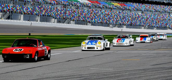 Six of the Brumos Racing Porsches run down pit lane as part of the honorary (59 at the 59th) celebration.