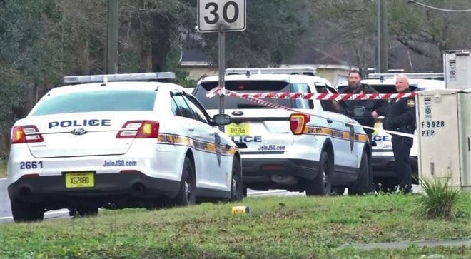 Officers investigate Monday morning's shooting on Wheat Road near Firestone Road in Jacksonville.
