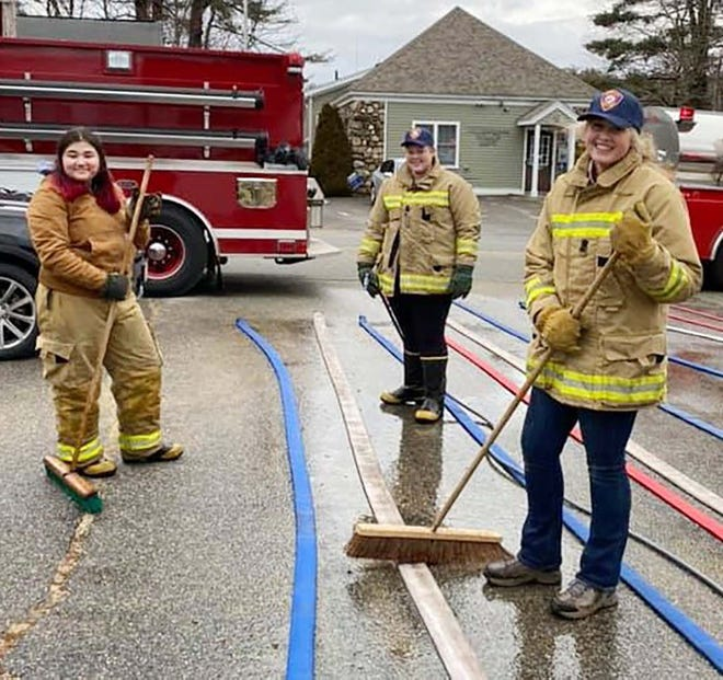 After a Dec. 31 fire in Petersham, Quabbin freshman and junior varsity basketball player Hannah Baxter, right, and fellow junior firefighters Ally Legare, left, and Amanda Scott scrub the PFD's hoses. Also in the junior firefighter program, but not pictured is Landon Guilmette.