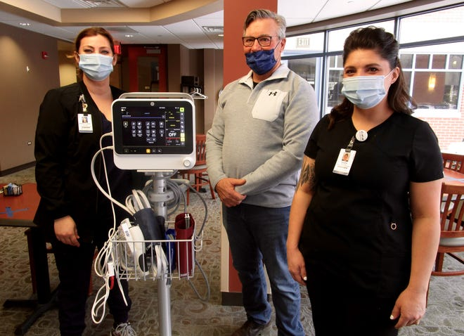 Heather Charlet, left, registered nurse and manager of the Med/Surgical Department at Hammond-Henry Hospital; Joe Mickley, a member of the Foundation's Annual Support Committee; and Tanayha Erdman, CAN , are shown by one of the two monitors purchased for the hospital with funds from the Foundation's 2020 Giving Project.
