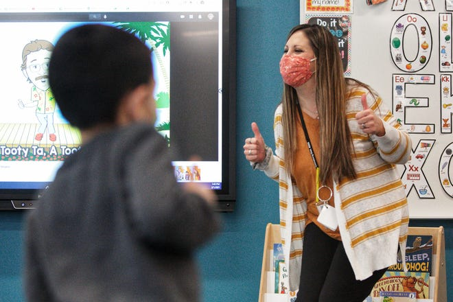 Dr. Martin Luther King Jr. Elementary School teacher Brooke Webber leads her kindergarten students in a dance during the first day of in-person learning in District 205 on Monday, Feb. 1, 2021.