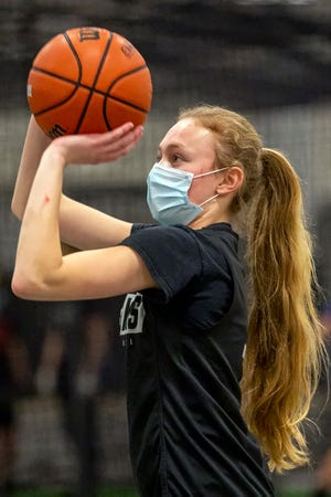 Galesburg High School senior guard Riley Jenkins puts up a shot during practice in the school's field house on Thursday, Jan. 28. [STEVE DAVIS/For The Register-Mail]