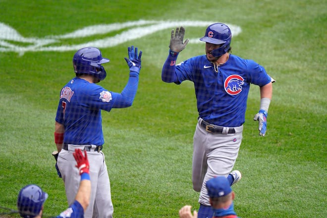 Chicago Cubs third baseman Kris Bryant, top right, is congratulated by teammates after hitting a solo home run during the second inning of a game against the Chicago White Sox in Chicago, Sunday, Sept. 27, 2020.