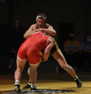 Fort Hays State's Marty Verhaeghe wrestles Newman's J.D. Johnson at 174 pounds on Sunday at Gross Memorial Coliseum.