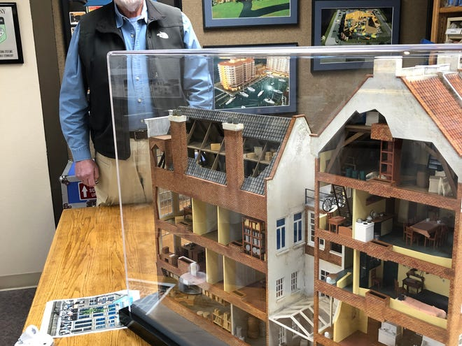 Dave VanDoren with his Global 3D-Arts' scale model of the Anne Frank House museum in Amsterdam.