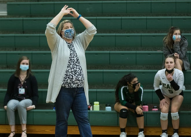 East Henderson coach Sabrina Cairnes coaches her team during a match earlier this season at East against Hendersonville.
