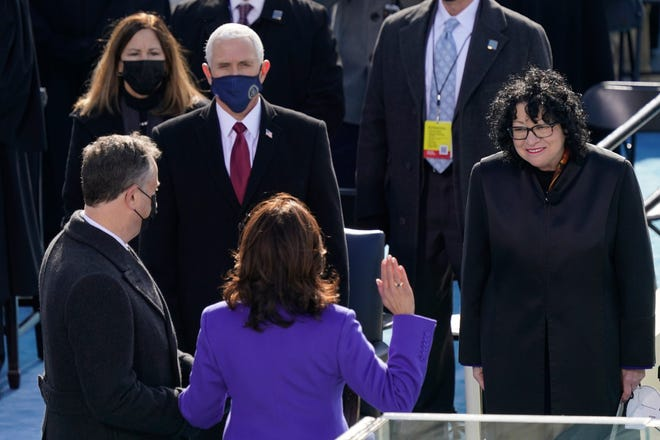 Kamala Harris is sworn in as Vice President by Supreme Court Justice Sonia Sotomayor as her husband Doug Emhoff holds the Bible during the 59th Presidential Inauguration at the U.S. Capitol in Washington, D.C. Jan. 20, 2021. Vice President Mike Pence and his wife Karen Pence look on. (AP Photo/Carolyn Kaster)