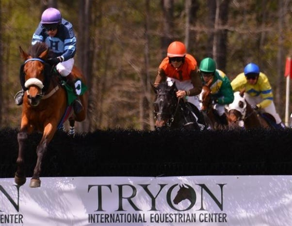 Jockeys compete in the 72nd Block House Steeplechase on April 14, 2018 at the Tryon International Equestrian Center.