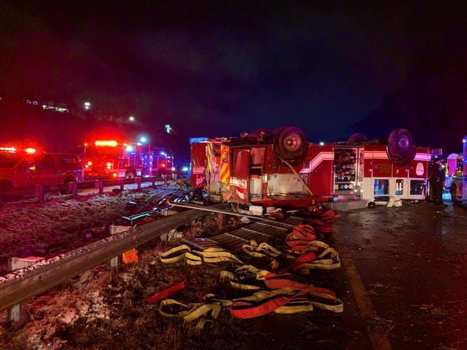 An Asheville Fire Department fire truck crossed the median on Interstate 26 Saturday night and rolled into oncoming traffic landing on its top.