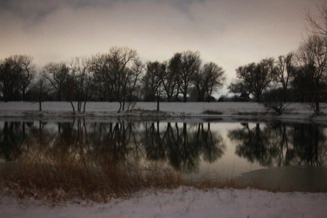 A beautiful photo of snowfall near the lake in Carey Park, in Hutchinson, on January 26, 2021.