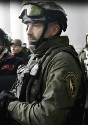 Donovan Crowl as he appeared during the riot Jan. 6 at the U.S. Capitol, according to federal prosecutors. Crowl has been charged with multiple crimes that stem from the riot, spurred by protests against the certification of Joe Biden's election as U.S. president.