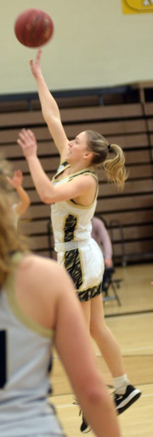 Newton High School sophomore Olivia Antonowich takes a jumper during play Saturday at the Newton Invitational.