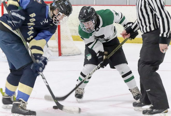 Aurora forward Nathan Funk faces off against the Kenston Bombers.