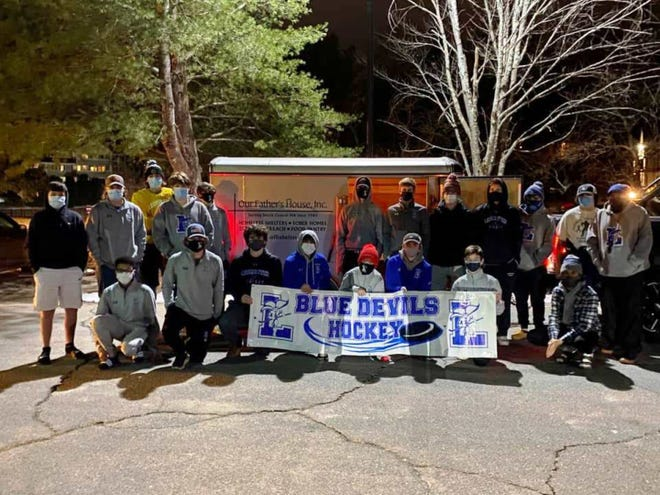 """The Leominster High School boys' hockey team collected items for and donated dozens of """"Warm Bags,"""" which include a hat, mittens, gloves, blanket, scarf, socks, and more, to the Our Father's House homeless shelter in Fitchburg."""