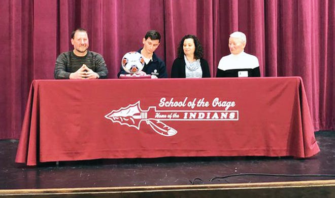 Osage senior Josh Cooper signs with Westminster College on January 28 in Osage Beach.