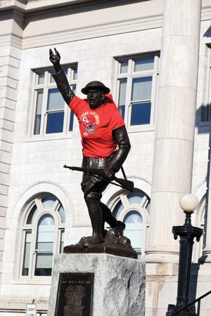 The doughboy statue at the Leavenworth County Courthouse sports a Kansas City Chiefs T-shirt on Friday. The T-shirt was placed on the statue Thursday and will remain in place until the day after the Super Bowl. The Chiefs will play the Tampa Bay Buccaneers in the Feb. 7 championship football game. The courthouse also is being illuminated in red at night ahead of the Super Bowl. A Chiefs T-shirt was placed on the doughboy statue last year ahead of the Chiefs' championship win.