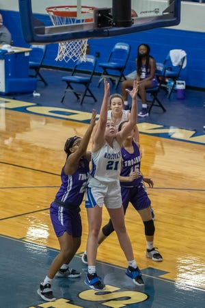 Midlothian's Sheridan Silvers (21) puts up an inside shot during a home game against Waco University in January. The Class 5A No. 24-ranked Lady Panthers are tied for first place in District 14-5A.