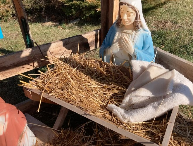 Burlington Ruritan members who went to the community Christmas display to put it away for another year found Mary looking down at an empty manger.