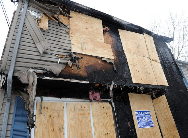 This duplex at 21 Lena Lane in Milford is boarded up following an overnight fire, Feb. 1, 2021.