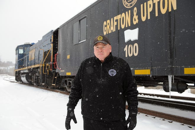 John Delli Priscoli, owner and CEO of the Grafton and Upton Railroad, at the Hopedale railyard, in front of the train from Franklin heading to Milford, Feb. 1, 2021.
