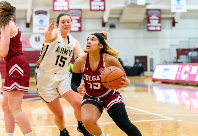 Colgate women's basketball guard Keelah Dixon (13) goes up for a basket against Army forward Kate Murray Jan. 31 at Cotterell Court in Hamilton. Dixon led the Raiders with 11 points but Army prevailed 79-45.