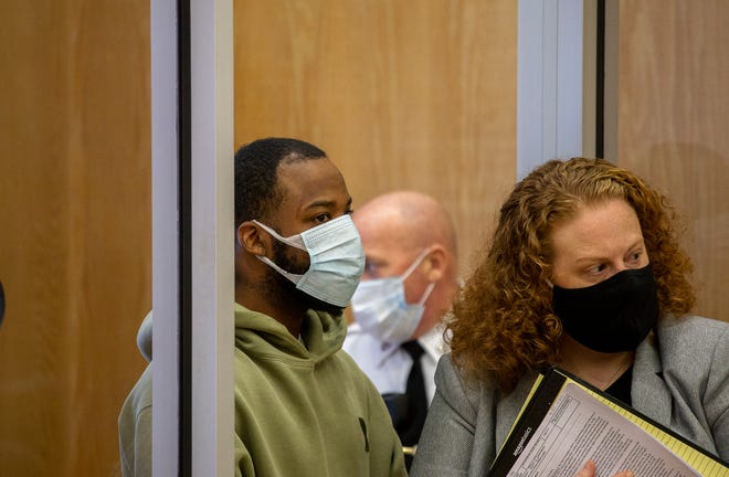 Devin Fuller, 29, of Boston, left, and his lawyer Moya Gibson in Stoughton District Court on Feb. 1, 2021. Fuller is accused of trying to kill a State Police trooper.