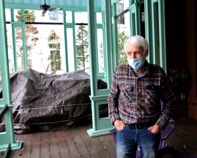 Bob Vaccaro, owner of the historic mansion at 411 Middle St. in Portsmouth, shows off the open-concept porch leading to the backyard gardens.