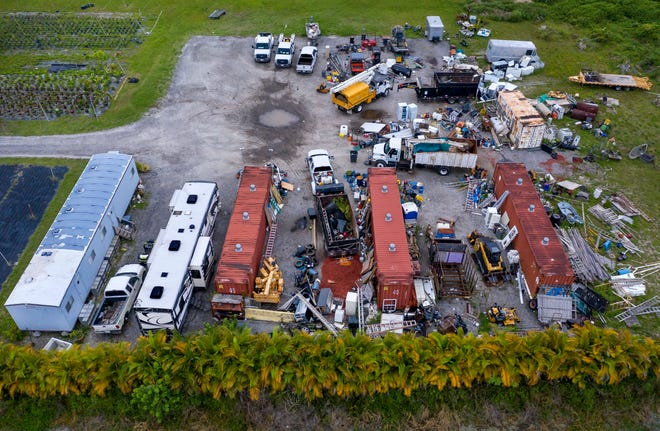 Nurseries that have become storage depots for landscape maintenance companies in Heritage Farms are in violation of the county zoning code.