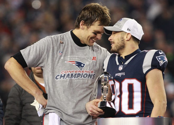 Tom Brady and receiver Danny Amendola share a moment during the trophy presentation after winning the AFC Championship 24-20 over the Jaguars on Jan. 21, 2018.