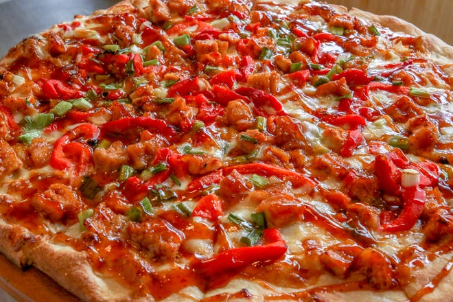 General Tso's pizza is a house favorite at Francesco's, a New York-style pizzeria just opened on Hope Street in Providence.