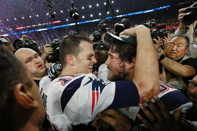 Patriots quarterback Tom Brady celebrates with center David Andrews after beating the Atlanta Falcons in the Super Bowl in 2017. Andrews is among more than 200 Brady teammates who have played in a Super Bowl.