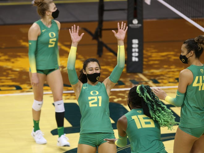Oregon's Kylie Robinson (21) celebrates with teammates during an earlier home match this season against UCLA.