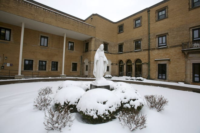 The statue of Mother Mary in the courtyard of Cleveland Clinic Mercy Hospital.