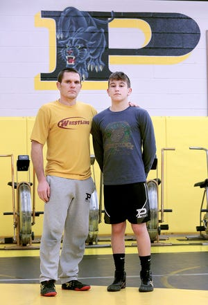 Brent and son Austin McBurney at the Perry Wrestling room.